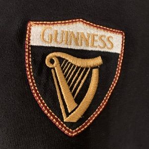 Black Guinness Polo Shirt With Harp Crest And Arthur Guinness Signature in Gold
